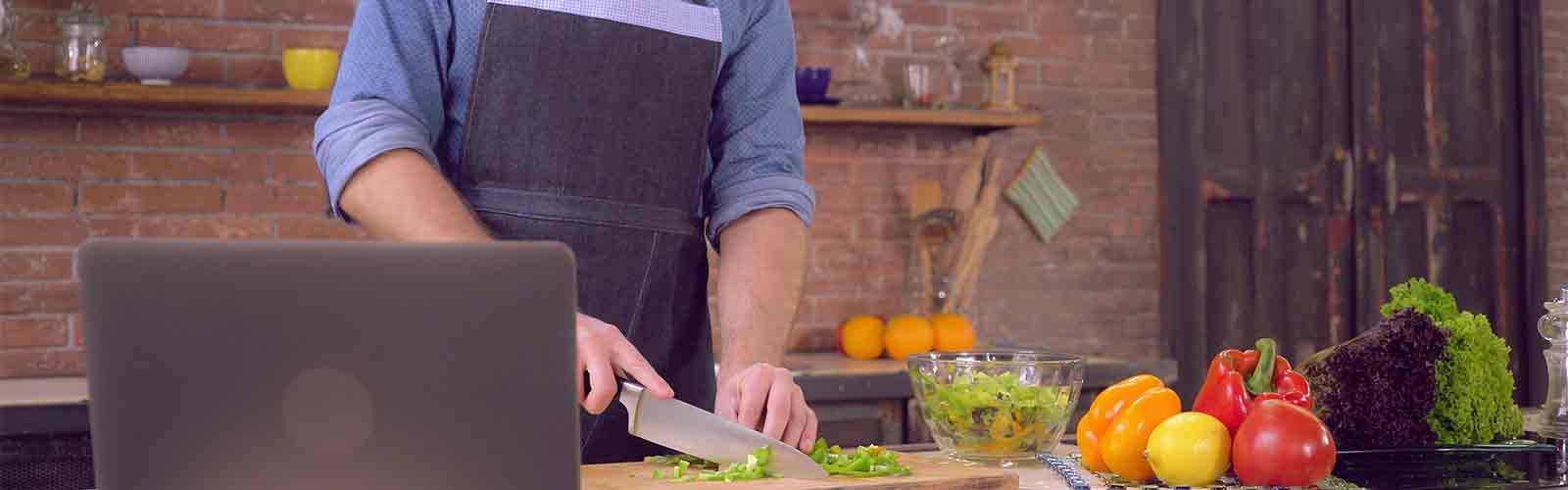 Man taking online cooking class
